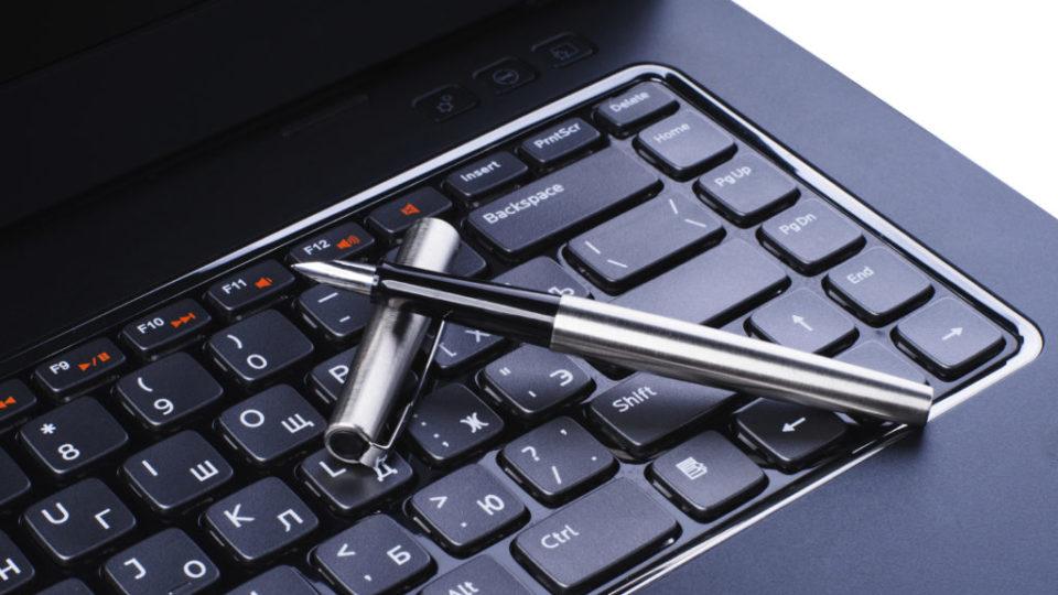 Fountain pen on laptop keyboard